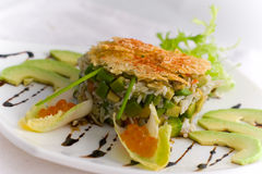 Crab salad. Decorated salad with crab meat Royalty Free Stock Image