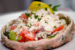 Crab salad served in the shell of spider-crab Royalty Free Stock Photography