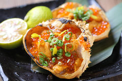 Crab and sea urchin, Kaiho grilled with salmon roe on hot black stock photos