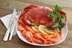 Crab with shrimp. And parsley on a wooden table Stock Photo