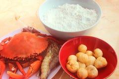 Crab, shrimp, fish balls and white powder stock image