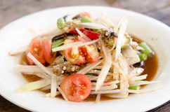 Crab Som Tum. Papaya Spicy Salad on White Dish Royalty Free Stock Photo
