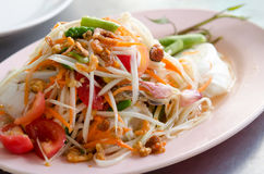 Crab Som Tum. Papaya Spicy Salad on White Dish Stock Photos