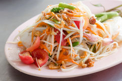Crab Som Tum. Papaya Spicy Salad on White Dish Royalty Free Stock Images