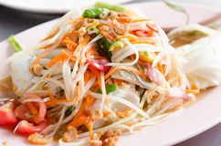 Crab Som Tum. Papaya Spicy Salad on White Dish Royalty Free Stock Photography
