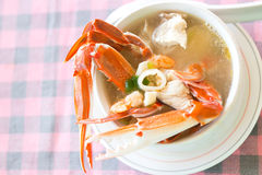 A crab soup in white plate Stock Images