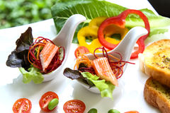 Crab stick canape. With salad Royalty Free Stock Image