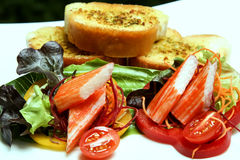 Crab stick salad. Crab stick and fresh vegetable Royalty Free Stock Photos