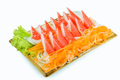Crab stick with fresh vegetables on white Stock Photo