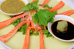 Crab stick meal, decorate crab stick in green plate Japanese foo stock images