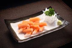 Crab stick sashimi with wasabi on ceramic dish Royalty Free Stock Image