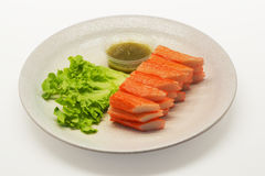 Crab stick serve with spicy sauce. On white background Stock Photos
