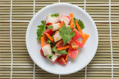 Crab stick spicy salad with vegetable. Royalty Free Stock Photos
