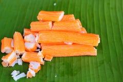 Crab sticks on a banana leaf Royalty Free Stock Image