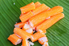 Crab sticks on a banana leaf Royalty Free Stock Images