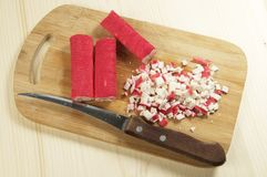 Crab sticks on a board cutted for salad Stock Image