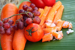 Crab sticks with fruits and vegetables Stock Photography