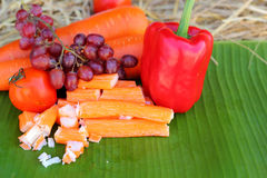 Crab sticks with fruits and vegetables Stock Images