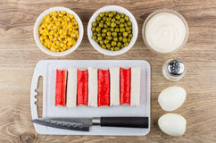 Crab sticks, peeled eggs, sweet corn, green peas, mayonnaise Stock Images