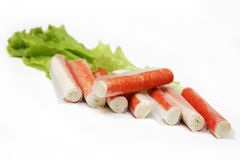 CRAB STICKS and salad. Isolated on the white Royalty Free Stock Photos