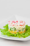Crab sticks salad on white tablecloth Royalty Free Stock Images