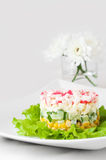 Crab sticks salad on white tablecloth Stock Images