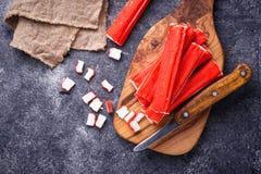 Crab sticks surimi and knife. Selective focus Stock Photo
