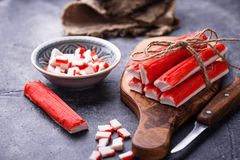 Crab sticks surimi and knife. Selective focus Royalty Free Stock Images
