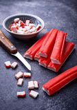 Crab sticks surimi and knife. Selective focus Royalty Free Stock Image