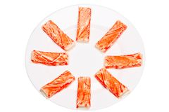 Crab sticks on a white plate. Isolated. White background stock photo