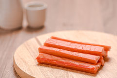 Crab sticks on wood table Royalty Free Stock Photography