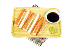 Crab sticks in wooden plate on table cloth Stock Images