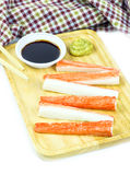 Crab sticks in wooden plate and table cloth Royalty Free Stock Photography