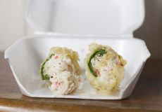 Crab Stuffed Jalapenos. Deep fried crab stuffed jalapenos in a carry out box Royalty Free Stock Photos