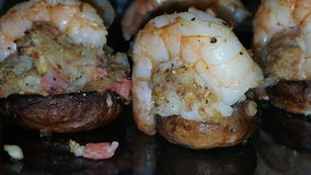 Crab stuffed mushrooms with shrimp on top Royalty Free Stock Photography