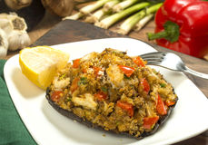 Crab stuffed portobello mushrooms. Crab stuffed portobello mushroom set on serving plate with fresh ingredients behind stock images