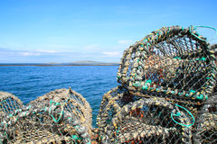Crab tand lobster traps on a pier, Ireland Stock Photos