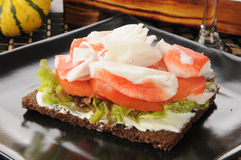 Crab and tomato with pumpernickel bread Stock Image