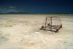 Crab Trap on Beach. Crab trap for salt water crab lying on the beach Royalty Free Stock Photos