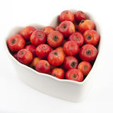 Crabapples in a heart shape bowl Stock Images