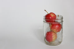 Crabapples in a Sealer Jar. Crabapples stacked in a sealer jar isolated on a white background Royalty Free Stock Photography