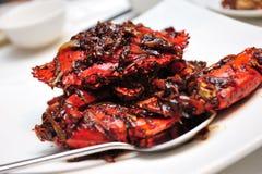 Crabe en sauce à poivre noir Photographie stock