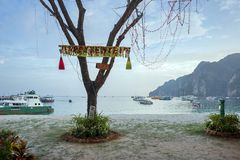 The tree is on the shore, decorated for the New Year, against the background of the sea with boats. Crabi,  Thailand - January 4: Krabi is a province of Stock Photography