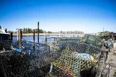 Crabpots e boe al porticciolo Fotografia Stock Libera da Diritti