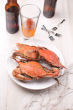 Crabs and beer dinner Royalty Free Stock Photos