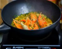 Crabs fried with curry in pan cooking stock photos