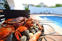 Crabs shrimps on charcoal grill Royalty Free Stock Image