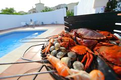 Crabs shrimps on charcoal grill Stock Photo