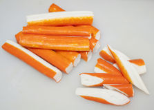 Crabstick. Fresh crab sticks cut on white kitchen table Royalty Free Stock Photo
