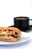 Crabstick Salad Baguette with Coffee. A crabstick salad baguette with a cup of white coffee Stock Photo